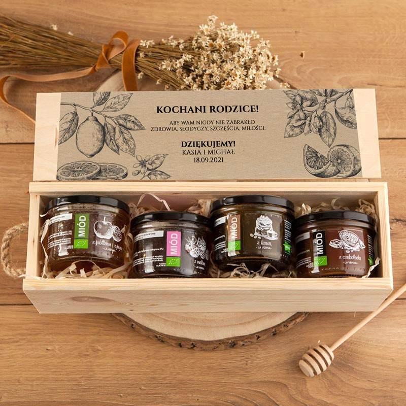 Drewniana personalizowana skrzynka z smakowymi miodami